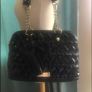 Betsey black quilted heart satchel